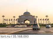 Abu Dhabi, UAE - March 31. 2019. The Arch main entrance to Presidential Palace On the Sunset. Редакционное фото, фотограф Володина Ольга / Фотобанк Лори