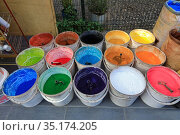 Market of building and finishing materials in the street. Multicolored powdered dyes in plastic buckets. Karakoy neighbourhood, Beyoglu district, Istanbul, Turkey. Редакционное фото, фотограф Bala-Kate / Фотобанк Лори