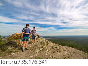 hikers men and women sit on top of mountain sugomak on summer sunny day. Стоковое фото, фотограф Акиньшин Владимир / Фотобанк Лори