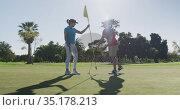 Two caucasian women playing golf one reaching for ball. Стоковое видео, агентство Wavebreak Media / Фотобанк Лори