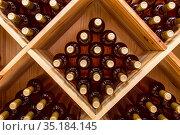 Stacked bottles of grape wine in a wine cellar. Стоковое фото, фотограф Наталья Волкова / Фотобанк Лори