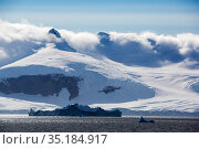 Snow covered mountains at edge of Lallemand Fjord, until recently large parts of the fjord were covered by the Muller ice shelf which collapsed due to... Стоковое фото, фотограф Ashley Cooper / Nature Picture Library / Фотобанк Лори
