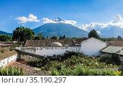 View of Antigua Guatemala and the volcano near the city. Стоковое фото, фотограф Николай Коржов / Фотобанк Лори