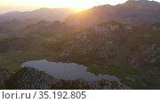 Mountain lake at sunset in Picos de Europa Natural Park. Spain. Стоковое видео, видеограф Яков Филимонов / Фотобанк Лори