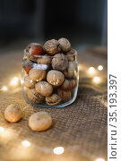 Mix of nuts in a jar on dark background. Walnuts and pine nuts. Top view. Copy space. Superfood, vegan, vegetarian food concept. Macro of walnut texture. selective focus. Healthy snack. Стоковое фото, фотограф Galina kondratenko / Фотобанк Лори