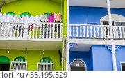 Fragment of Colorful green and blue  house  in a cute neighborhood. Traditional Spanish architecture. Guatemala. Flores, El Peten. Редакционное фото, фотограф Николай Коржов / Фотобанк Лори