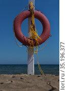 Red lifebuoy on a pole near the seashore. Стоковое фото, фотограф Юрий Бизгаймер / Фотобанк Лори