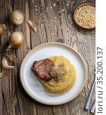 Czech cuisine, smoked meat with pea porridge and fried onion until... Стоковое фото, фотограф Richard Semik / easy Fotostock / Фотобанк Лори