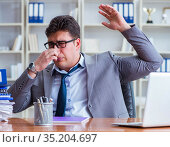 Businessman sweating excessively smelling bad in office at workp. Стоковое фото, фотограф Elnur / Фотобанк Лори