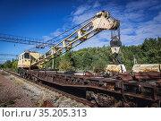 Railroad crane in abandoned Yaniv town railway station, Chernobyl... Стоковое фото, фотограф Konrad Zelazowski / age Fotostock / Фотобанк Лори