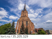 Front facade and a bell tower of Cathedral Basilica of St James the... Стоковое фото, фотограф Konrad Zelazowski / age Fotostock / Фотобанк Лори