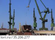 Ship hull under construction at shipyard. Стоковое фото, фотограф Юрий Бизгаймер / Фотобанк Лори