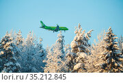S7 Airlines Embraer ERJ-170-100SU 170SU is arriving to the International Petrozavodsk airport. Winter. Редакционное фото, фотограф Сергей Цепек / Фотобанк Лори