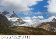 Fluhalp Hotel in the alps, Findel glacier in background. Zermatt, Valais, Switzerland. September 2019. Стоковое фото, фотограф Graham Eaton / Nature Picture Library / Фотобанк Лори