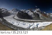 Gorner Glacier amongst Monte Rosa, Breithorn and Pollux mountains. Zermatt, Valais, Switzerland. September 2019. Стоковое фото, фотограф Graham Eaton / Nature Picture Library / Фотобанк Лори