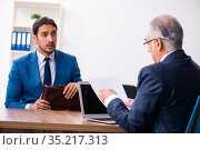 Young male candidate employee meeting with old recruiter. Стоковое фото, фотограф Elnur / Фотобанк Лори