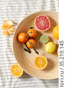 close up of citrus fruits on wooden plate. Стоковое фото, фотограф Syda Productions / Фотобанк Лори
