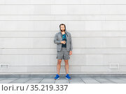 sportsman with bottle of water in city. Стоковое фото, фотограф Syda Productions / Фотобанк Лори