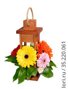 Wooden decorative lantern with flowers over white. Стоковое фото, фотограф Бражников Андрей / Фотобанк Лори