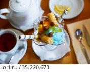 Dessert of two scoops of ice cream, waffle and chocolate candy. Стоковое фото, фотограф Яков Филимонов / Фотобанк Лори