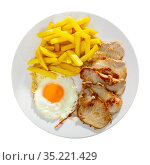 close up of grilled pork with fried potato and egg served. Стоковое фото, фотограф Яков Филимонов / Фотобанк Лори