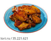Fried chicken wings with golden crust served with on plate. Стоковое фото, фотограф Яков Филимонов / Фотобанк Лори