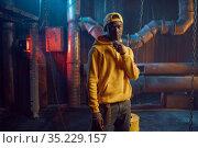 Stylish rapper in yellow hoodie and baseball cap. Стоковое фото, фотограф Tryapitsyn Sergiy / Фотобанк Лори