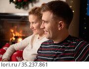 Christmas Couple at home by the fireplace. Стоковое фото, фотограф Алексей Кузнецов / Фотобанк Лори