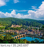 Heidelberg town with old Karl Theodor bridge and castle on Neckar... Стоковое фото, фотограф Zoonar.com/NIKOLAY OKHITIN / easy Fotostock / Фотобанк Лори