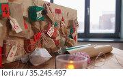 christmas advent calendar on table at home. Стоковое видео, видеограф Syda Productions / Фотобанк Лори