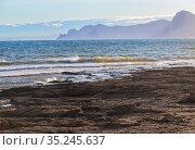 Beautiful seascape with rocky shore and mountains. Стоковое фото, фотограф Юрий Бизгаймер / Фотобанк Лори