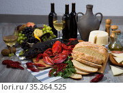 Smoked sturgeon and lobster with crayfishes, fruits and wine. Стоковое фото, фотограф Яков Филимонов / Фотобанк Лори