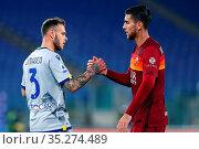 Lorenzo Pellegrini (Roma) greets Federico Dimarco (Verona) at the... Редакционное фото, фотограф Federico Proietti / Sync / AGF/Federico Proietti / / age Fotostock / Фотобанк Лори