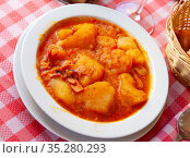 Dish of Mediterranean cuisine - braised squid with potatoes. Стоковое фото, фотограф Яков Филимонов / Фотобанк Лори