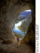 Exit from a large cave located in the Ural Mountains in Bashkortostan, Russia. Стоковое фото, фотограф Акиньшин Владимир / Фотобанк Лори