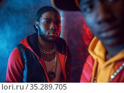 Two serious rappers with gold jewelry in studio. Стоковое фото, фотограф Tryapitsyn Sergiy / Фотобанк Лори