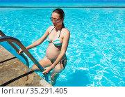 Pregnant woman exits swimming pool vacation photo. Стоковое фото, фотограф Сергей Новиков / Фотобанк Лори