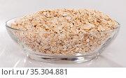 Oat flakes in glass bowl. Стоковое фото, фотограф Яков Филимонов / Фотобанк Лори