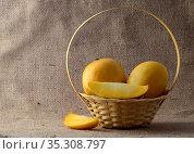Mango fruit in basket on sack cloth background. Стоковое фото, фотограф Dipak Chhagan Shelare / easy Fotostock / Фотобанк Лори