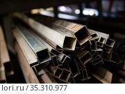 Iron tubes, pipes, profiles on rack. Стоковое фото, фотограф Яков Филимонов / Фотобанк Лори