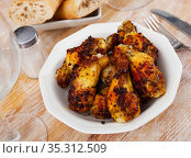 Tasty crispy grilled chicken wings on plate. Стоковое фото, фотограф Яков Филимонов / Фотобанк Лори