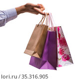 Hand holding shopping bags with christmas shopping on white back. Стоковое фото, фотограф Elnur / Фотобанк Лори