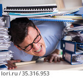 Extremely busy businessman working in office. Стоковое фото, фотограф Elnur / Фотобанк Лори