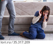 Desparate wife with aggressive husband in domestic violence conc. Стоковое фото, фотограф Elnur / Фотобанк Лори
