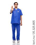 indian doctor or male nurse showing stop gesture. Стоковое фото, фотограф Syda Productions / Фотобанк Лори