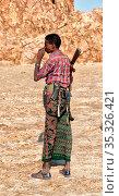 ETHIOPIA,DANAKIL-CIRCA JANUARY 2018--unidentified irregular soldier... Стоковое фото, фотограф Zoonar.com/LKPRO / age Fotostock / Фотобанк Лори