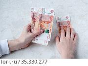 A lot of Russian five-thousand-dollar bills in women's hands, the concept of big money. Стоковое фото, фотограф Катерина Белякина / Фотобанк Лори