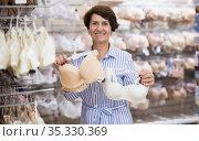 mature woman choosing bra in supermarket. Стоковое фото, фотограф Татьяна Яцевич / Фотобанк Лори