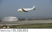Large passenger airliner of Vueling Airlines with EC-MXP registration number landing in International El Prat Airport in Barcelona (2020 год). Редакционное видео, видеограф Яков Филимонов / Фотобанк Лори