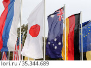 Baden-Baden, Germany, national flags of Russia, Japan, Australia, Germany and the flag of the European Union. Редакционное фото, агентство Caro Photoagency / Фотобанк Лори